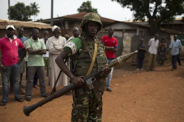 An African Union (AU) soldier stands guard outside a home in a Muslim neighbourhood in Central African Republic's capital Bangui, March 23, 2014. REUTERS/Siegfried Modola