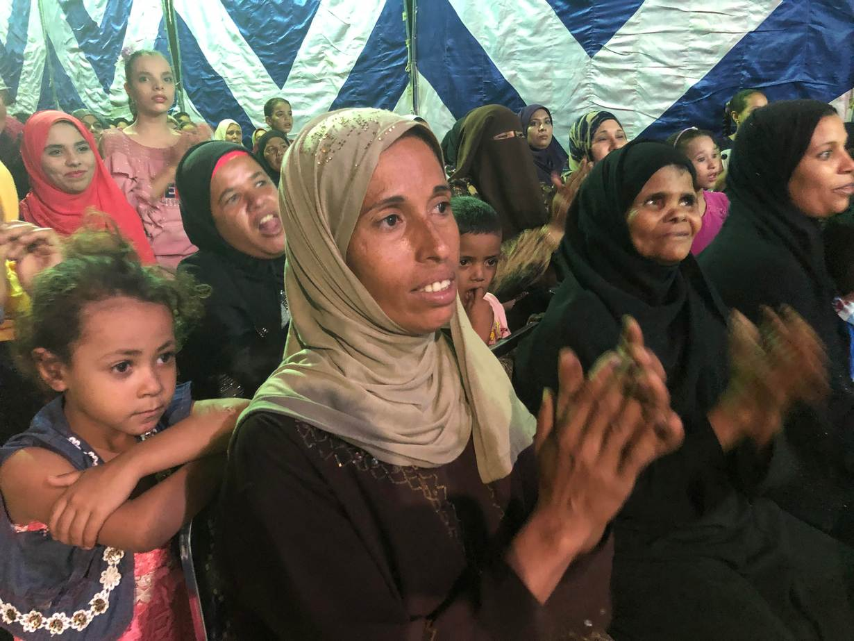 Audience members watch a performance of a comedy designed to teach farmers about climate change in the Upper Egyptian city of Assuit on September 13, 2019. Thomson Reuters Foundation/Menna A. Farouk