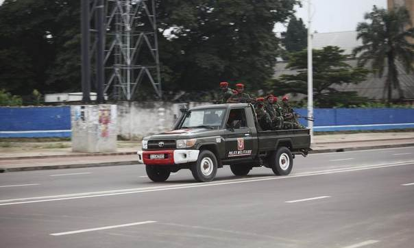 Congolese soldiers ride on their pick-up truck towards the state television headquarters in the capital Kinshasa, December 30, 2013. REUTERS/Jean Robert N'Kengo