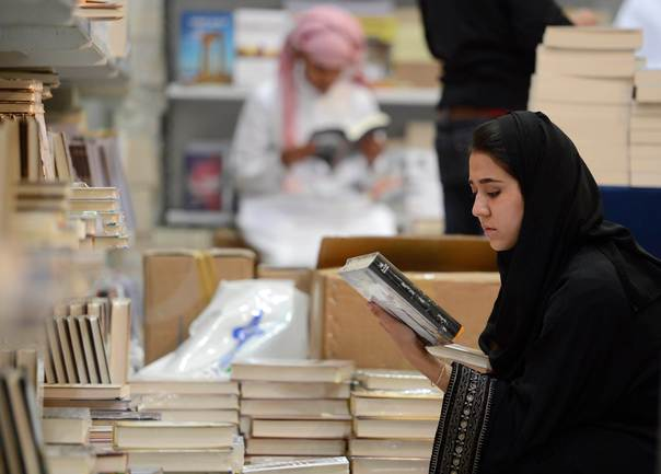 A woman looks at a book during the Riyadh Book Fair on March 9, 2013. REUTERS/Faisal Al Nassar