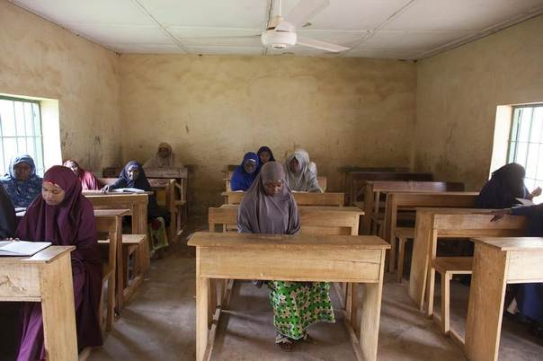 Women study Hadith excerpts at Maska Road Islamic School in Kaduna, July 16, 2014. The school teaches a creed that condemns the violent ideology of groups like Boko Haram.  REUTERS/Joe Penney