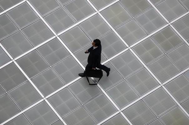 A man walks on a street in the business district in Tokyo April 17, 2014 REUTERS/Yuya Shino