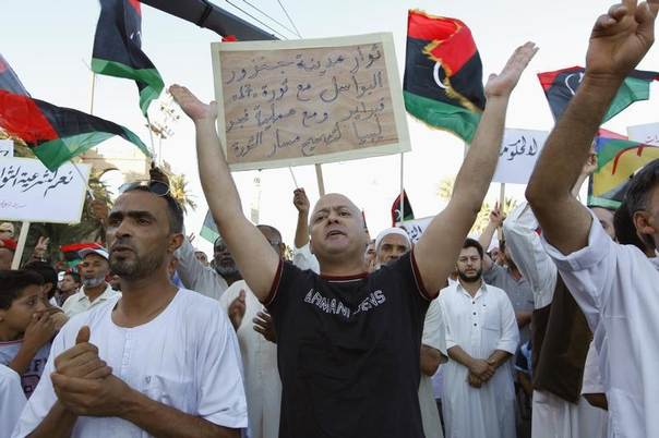 Supporters of Operation Dawn, a group of Islamist-leaning forces mainly from Misrata, demonstrate against the Libyan parliament and against last week's air strikes of rebel positions in Tripoli at Martyrs' Square in Tripoli August 29, 2014. REUTERS/Ismail Zitouny