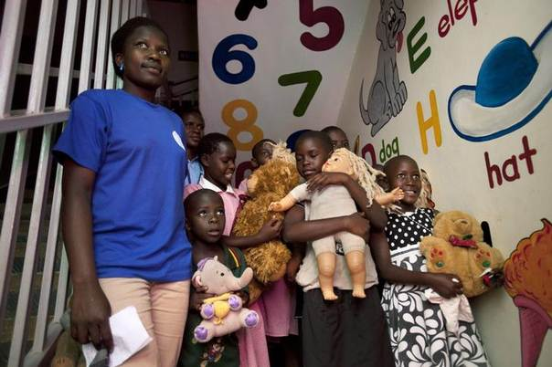 HIV positive children and AIDS orphans at Reach Out Mbuya, a health clinic in Kampala that does HIV/AIDS community outreach, hold stuffed animals and dolls as U.S. Secretary of State Hillary Clinton (not pictured) visits the clinic. August 3, 2012 REUTERS/Jacquelyn Martin/Pool