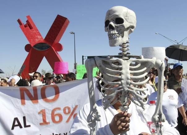 Demonstrators carry a replica of skeletons during a march along the streets in Ciudad Juarez October 19, 2013, to protest against the federal government's economic and tax reforms according to local media REUTERS/Jose Luis Gonzalez