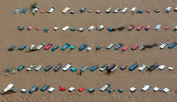 An aerial view of vehicles submerged in flood waters along the South Platte River near Greenley, Colorado on September 14, 2013. REUTERS/John Wark