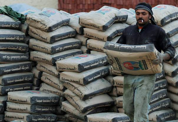 A labourer carries a pack of cement at a construction site on the outskirts of Cairo on January 23, 2011. REUTERS/Mohamed Abd El-Ghany