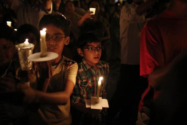 Children hold candles while participating in a vigil to mark Earth Hour in Mumbai, March 23, 2013. REUTERS/Danish Siddiqui