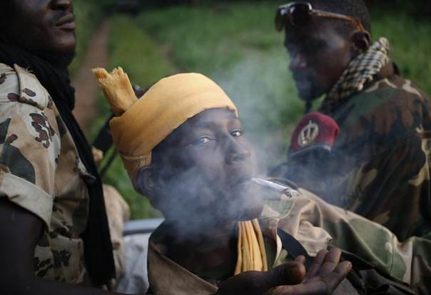 A Seleka fighter smokes during a patrol, close to the border of the Democratic Republic of Congo June 10, 2014. REUTERS/Goran Tomasevic