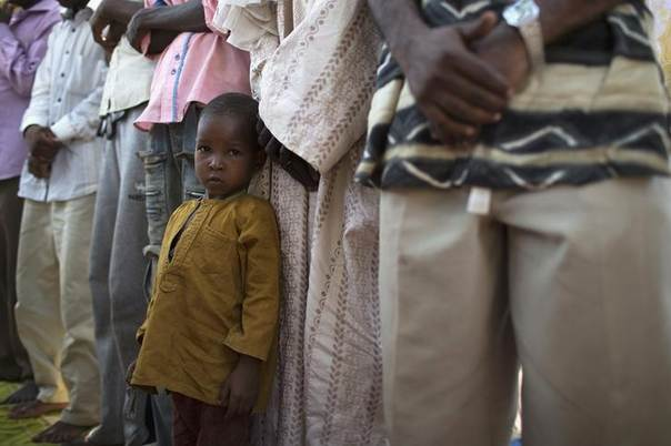 A child looks on during Friday prayers outside a mosque in a Muslim neighbourhood in the capital Bangui January 17, 2014. REUTERS/Siegfried Modola