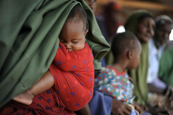 A baby sleeps as Somali refugees arrive at the reception center in Ifo settlement at Kenya's Dadaab Refugee Camp, situated northeast of the capital Nairobi near the Somali border in 2011. REUTERS/Jonathan Ernst