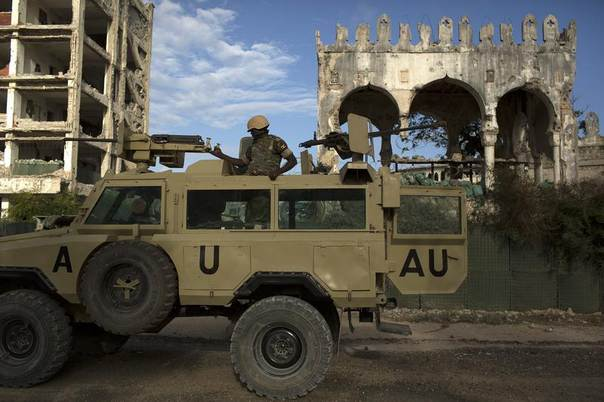 An African Mission in Somalia (AMISOM) soldier keeps guard on top of an armoured vehicle in the old part of Mogadishu, Somalia, November 13, 2013. REUTERS/Siegfried Modola
