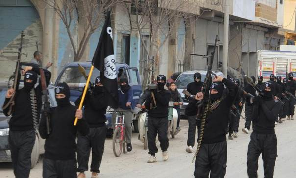 Fighters of the al-Qaeda linked Islamic State of Iraq and the Levant parade through the Syrian town of Tel Abyad, near the border with Turkey January 2, 2014. REUTERS/Yaser Al-Khodor