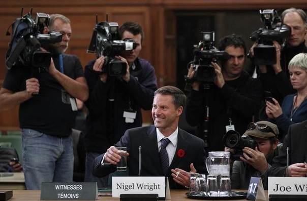 In this 2010 file photo, Nigel Wright, Canadian Prime Minister Stephen Harper's incoming chief of staff, prepares to testify before the Commons ethics committee on Parliament Hill REUTERS/Chris Wattie