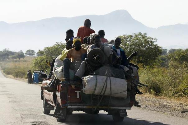 Passengers sit on their goods as they travel on a truck to a market in Gombe, north central Nigeria, November 29, 2013. REUTERS/Afolabi Sotunde