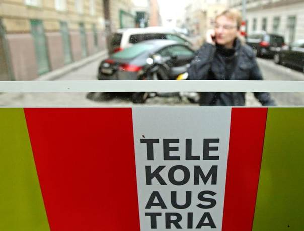 A man talks on his mobile phone outside a Telekom Austria phone booth in Vienna January 9, 2014 REUTERS/Heinz-Peter Bader