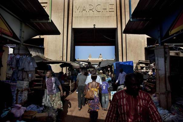 People walk past the entrance to the main market in Bobo Dioulasso, Burkina Faso, September 24, 2012. REUTERS/Joe Penney