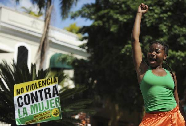 A woman participates in a march to celebrate International Day for the Elimination of Violence Against Women, in Santo Domingo, Dominican Republic, Nov. 25, 2013. REUTERS/Ricardo Rojas