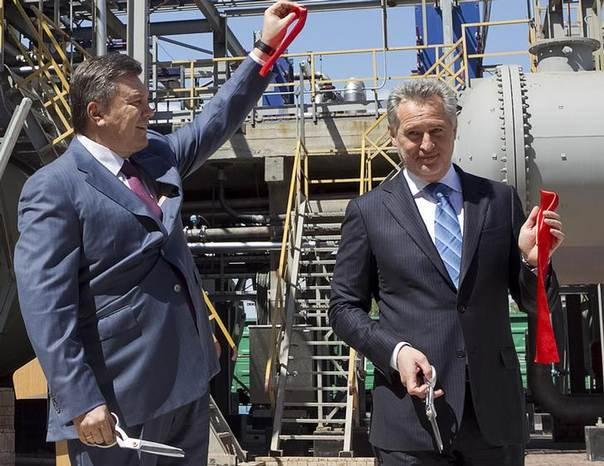In this 2012 file photo, Dmytro Firtash, one of Ukraine's richest men, (R) and then Ukrainian President Viktor Yanukovich take part in an opening ceremony of a new complex for the production of sulfuric acid in Crimea region REUTERS/Mykhailo Markiv