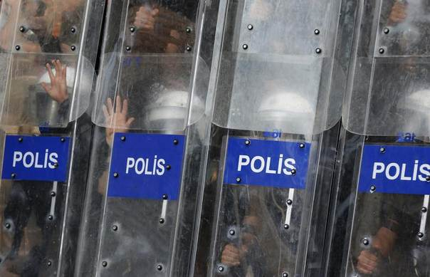 Riot police use their shields to protest themselves as they clash with protesters in central Istanbul, Turkey, July 8, 2013. REUTERS/Murad Sezer
