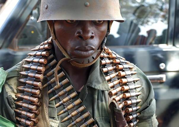A Democratic Republic of the Congo soldier stands at an army barrack in the town of Bria April 9, 2014. REUTERS/Goran Tomasevic