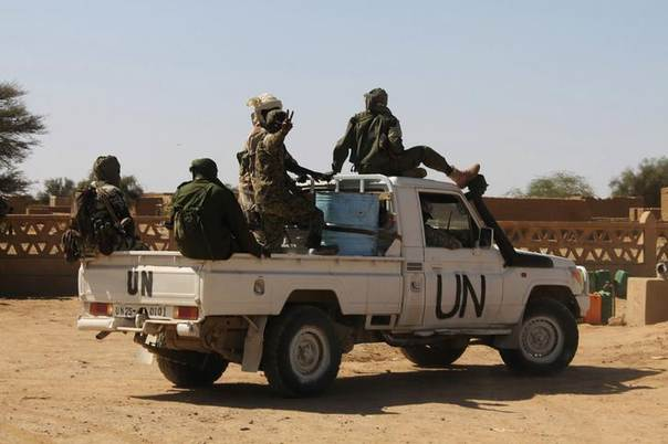 Chadian U.N. peacekeepers gesture as they patrol during a ceremony marking two years since Malian soldiers were killed in a massacre by radical Islamists, in Aguelhok, Mali January 24, 2014. Picture taken January 24, 2014. REUTERS/Stringer