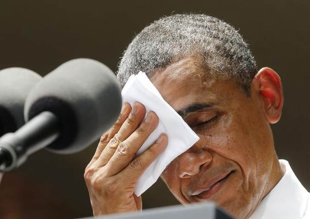 U.S. President Barack Obama pauses and wipes his face as he speaks about his vision to reduce carbon pollution while preparing the country for the impacts of climate change, at Georgetown University in Washington, June 25, 2013. REUTERS/Larry Downing