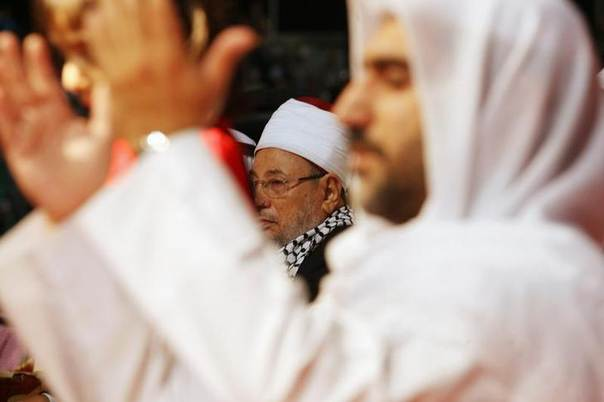 In this 2009 file photo, Qatar's Egyptian-born cleric Sheikh Youssef al-Qaradawi (C) attends a protest against Israel at the Qatar Sports Club in Doha REUTERS/Fadi Al-Assaad