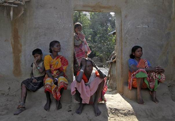 Villagers sit near the area where a woman was gang-raped at Birbhum district in the eastern Indian state of West Bengal, January 24, 2014. REUTERS/Stringer