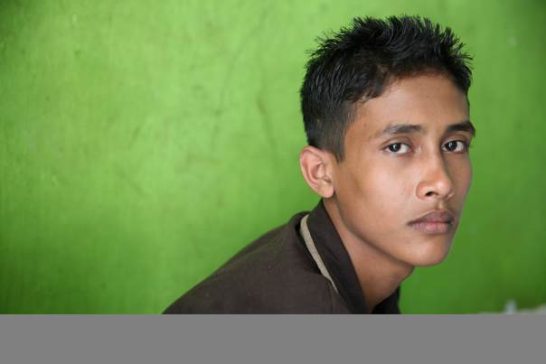 Mohammad Hashim, 18, fled Myanmar after his house was burnt down and life in a displacement camp became unbearable. He was detained by Malaysian authorities for four months. Taken by Thomson Reuters Foundation Correspondent in Kuala Lumpur, on June 1, 2013.