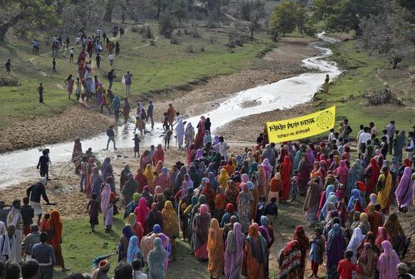 Indian villagers protest against a coal mining project in Singrauli district in Madhya Pradesh. A new forest law gives people more say over how natural resources are exploited. Picture February 27, 2014, Thomson Reuters Foundation/ Nita Bhalla