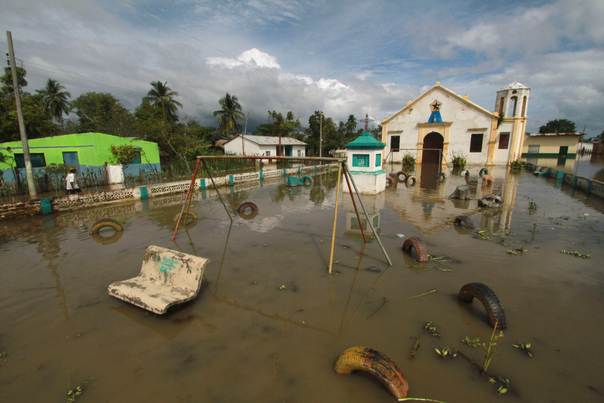 A general view shows a flooded church at San Roque village on the riverbank of Magdalena, Colombia, on December 17, 2011. REUTERS/Joaquin Sarmiento