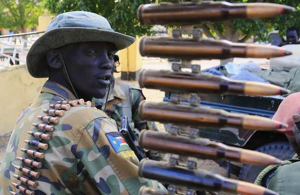 A South Sudan army soldier stands next to a machine gun mounted on a truck in Malakal town, 500km (310 miles) northeast of the capital Juba, on December 30, 2013, a few days after retaking the town from rebel fighters. REUTERS/James Akena