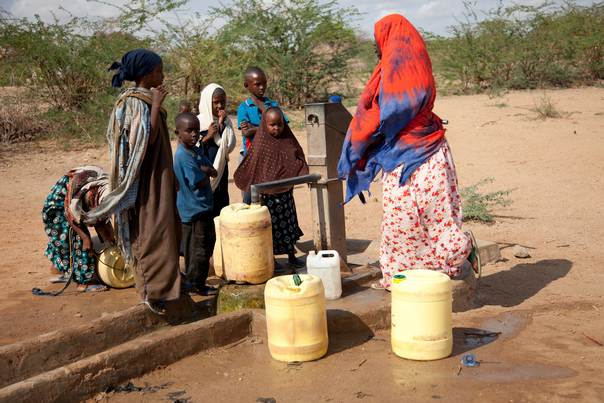 People collect water at a well in Garissa, Kenya, on August 2, 2011. REUTERS/Ken Oloo/International Federation of Red Cross and Red Crescent Societies/Handout