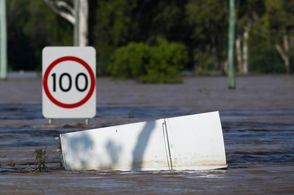 A refrigerator floats in floodwaters on a highway in Rockhampton, Queensland, Australia, on January 4, 2011. REUTERS/Daniel Munoz