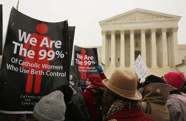 Protesters rally at the steps of the Supreme Court as arguments begin today to challenge the Affordable Care Act's requirement that employers provide coverage for contraception as part of an employee's health care, in Washington March 25, 2014. REUTERS/Larry Downing