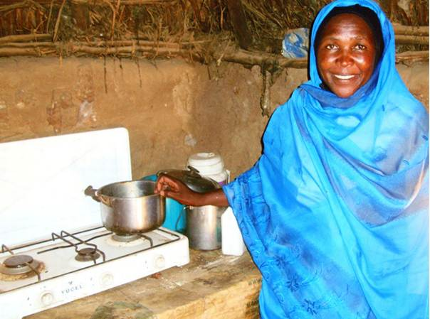 A women stands next to an energy-efficient LPG cookstove in El Fasher, Darfur, Sudan. PHOTO/Carbon Clear