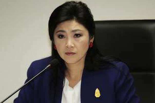 Prime Minister Yingluck Shinawatra attends her cabinet economic meeting at the office of the Permanent Secretary of Defense in Bangkok April 21, 2014 REUTERS/stringer