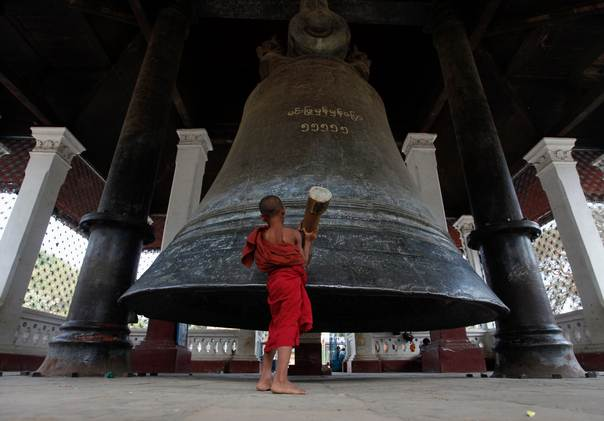 A novice monk rings the Mingun Bell, which is the world's third largest bell, in Mingun village, Myanmar, on March 4, 2012. REUTERS/Soe Zeya Tun
