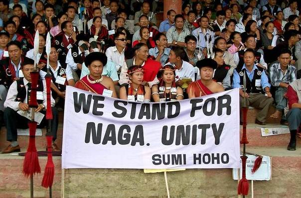 Naga tribesmen sit after a march in Kohima, capital of the northeast Indian state of Nagaland, to back demands for an expansion of Nagaland. Picture August 31, 2005, REUTERS/Stringer