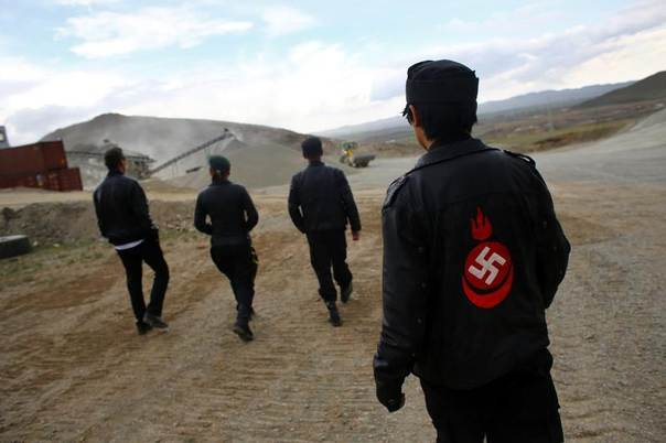 Members of the Mongolian neo-Nazi group Tsagaan Khass walk through a quarry, where they questioned a worker, southwest of Ulan Bator June 23, 2013. REUTERS/Carlos Barria