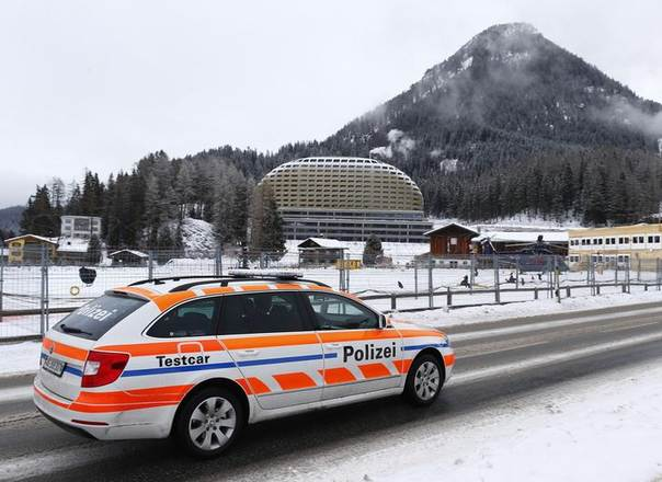 A police car patrols in front of the InterContinental Hotel before the start of the annual meeting of the World Economic Forum (WEF) 2014 in Davos, Switzerland, January 21, 2014.  REUTERS/Ruben Sprich