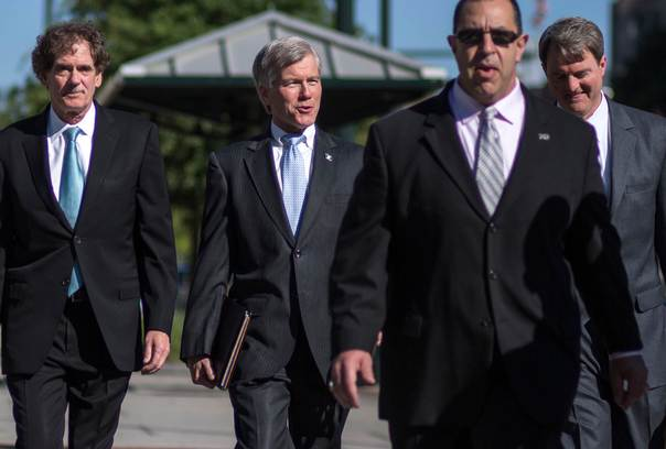 Former Virginia Governor Robert McDonnell (second from L) arrives with his legal team for his trial in Richmond, Virginia, on July 28, 2014. McDonnell, 60, a Republican once mentioned as a potential presidential candidate, and the former first lady faced a 14-count indictment alleging they accepted about $165,000 from a Virginia businessman in exchange for helping his dietary supplement company. REUTERS/Jay Westcott