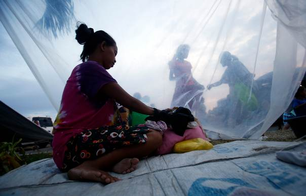 A pregnant woman sits in a makeshift shelter for families displaced by fighting between government soldiers and Muslim rebels of Moro National Liberation Front (MNLF) in Zamboanga city in southern Philippines, on Sept. 18, 2013. REUTERS/Erik De Castro