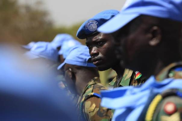 Ghanian U.N. peacekeepers stand at attention upon arriving in Juba February 28, 2014.  REUTERS/Andreea Campeanu