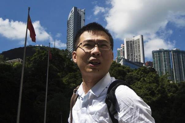 Li Jianjun, former investigative reporter from the coal-rich province of Shanxi, leaves the High Court of Hong Kong August 5, 2013. Li who had been airing accusations via the internet against China Resources' (Holdings) chairman Song Lin, announced he would visit Hong Kong's anti-graft bodies Independent Commission Against Corruption (ICAC) on Monday and turn over evidence on alleged mismanagement, negligence and corrupt activities involving dozens of senior corporate executives, local media reported. REUTERS/Tyrone Siu