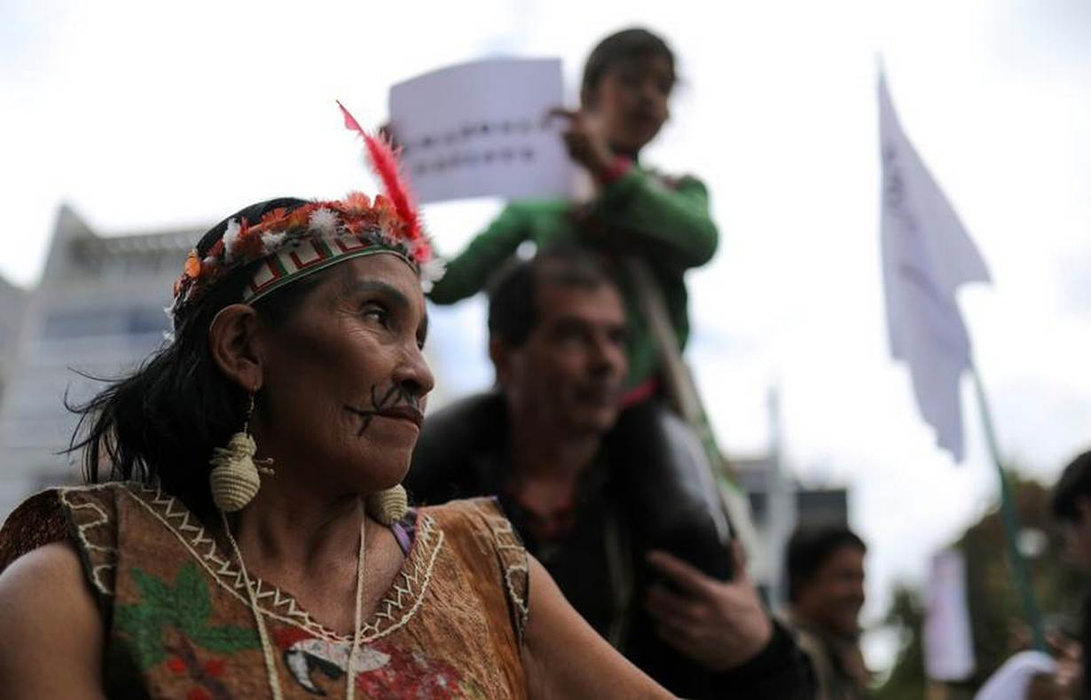 FILE PHOTO: An indigenous woman looks on as she attends a protest outside the Brazilian embassy due to the wildfires in the Amazon rainforest, in Bogota, Colombia August 23, 2019. REUTERS/Luisa Gonzalez