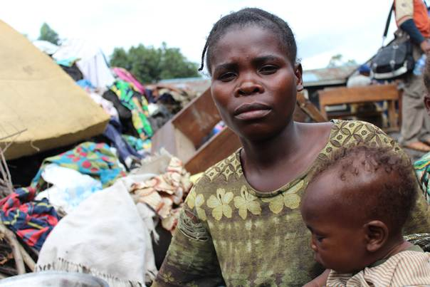 Mom with her baby at Lac Vert camp, North Kivu, Adel Sarkozi/CARE International 2013