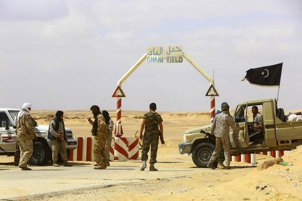 Rebels under Libyan rebel leader Ibrahim Jathran guard the entrance of the al-Ghani oil field, which is currently under the group's control, south of Ras Lanuf, Libya, March 18, 2014. REUTERS/Stringer