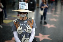 A woman who declined to give her name wears an outfit with the names of all the men in Hollywood who sexually harrassed her during a protest march for survivors of sexual assault and their supporters in Hollywood, Los Angeles, California
